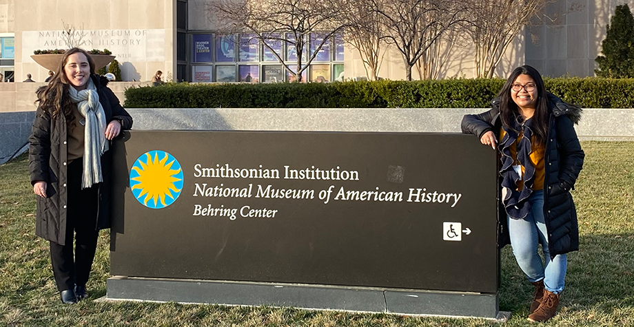 McKenna Decker '20 and Juliette Garcia '20 stand in front of the Smithsonian sign