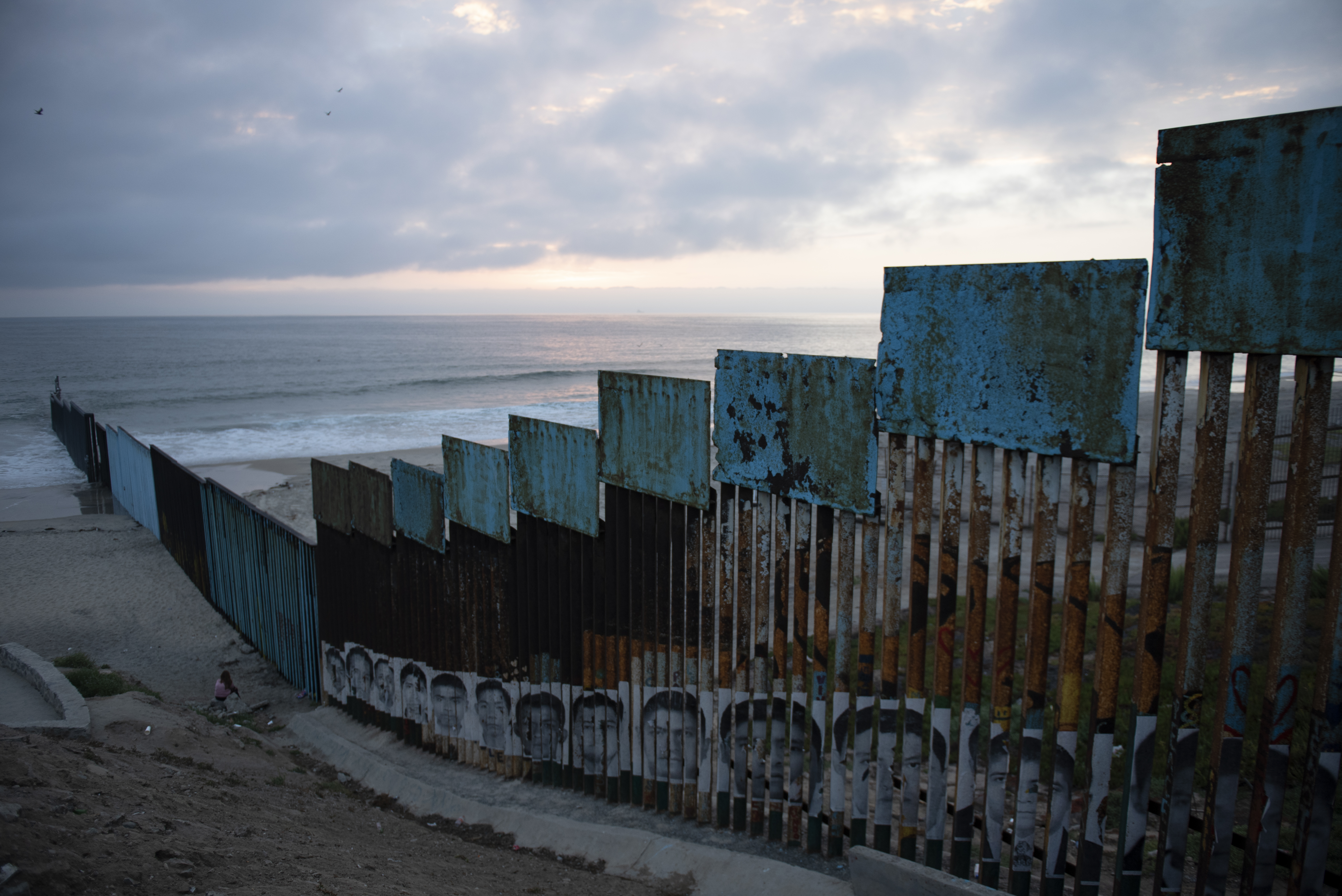 In Tijuana, the border wall between the United States and Mexico features protest art and portraits of missing students, and extends into the Pacific Ocean.