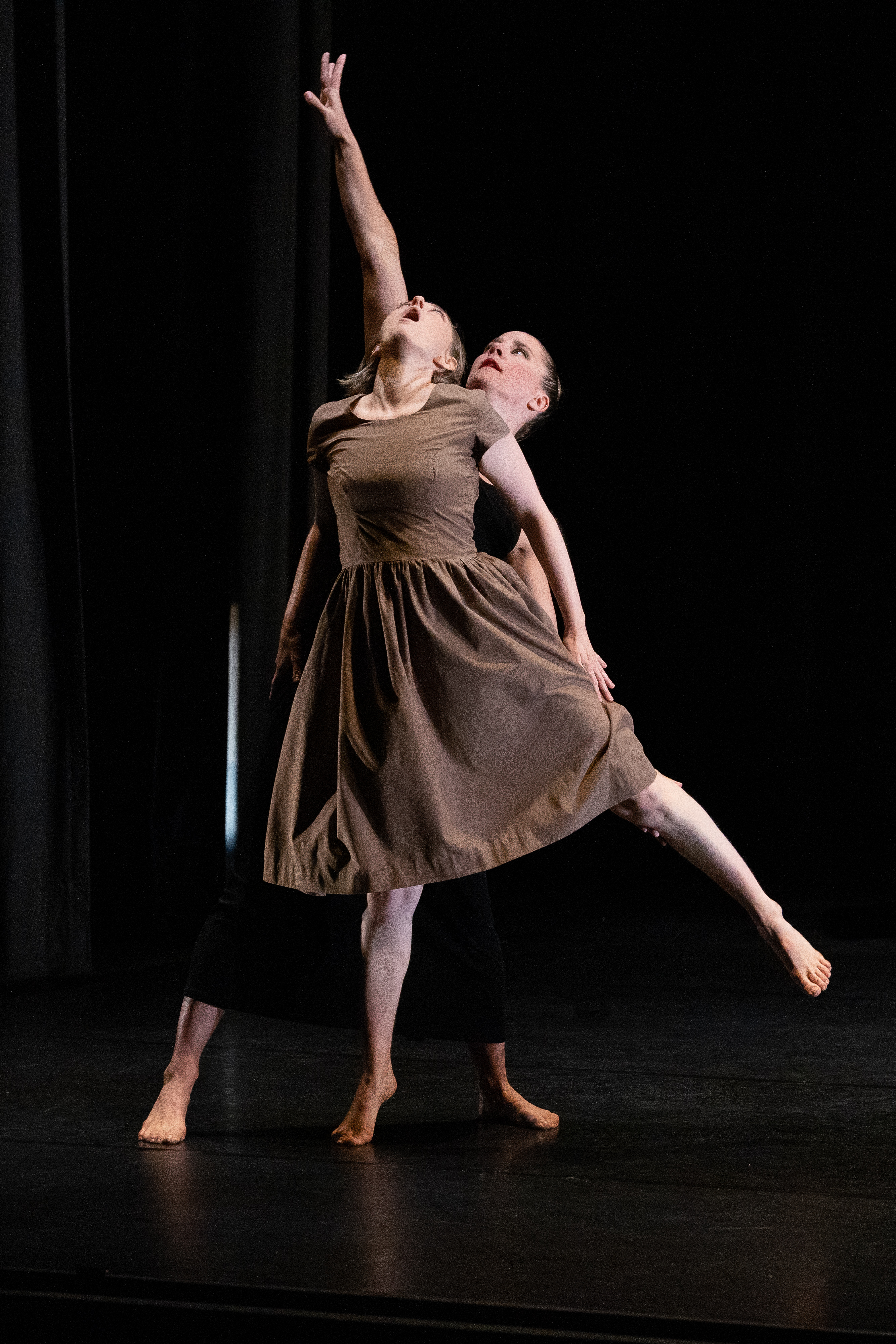 Two dancers perform on stage