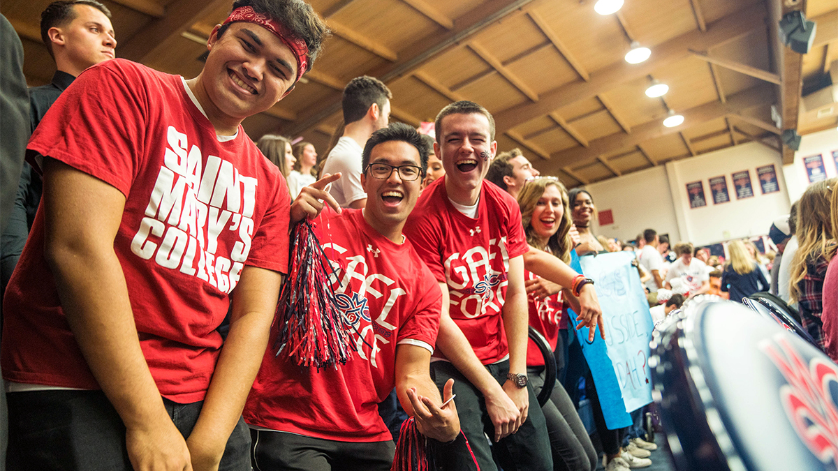 Students cheer in their Gael Force shirts inside McKeon Pavilion.