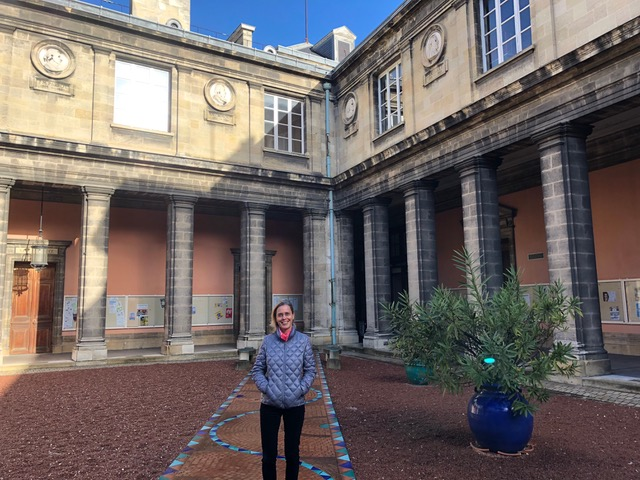 World Languages and Cultures Professor Helga Lenart-Cheng  in the courtyard of the University of Bordeaux, France.