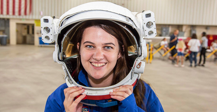 Kylie Vandenson poses for the camera in an astronaut helmet