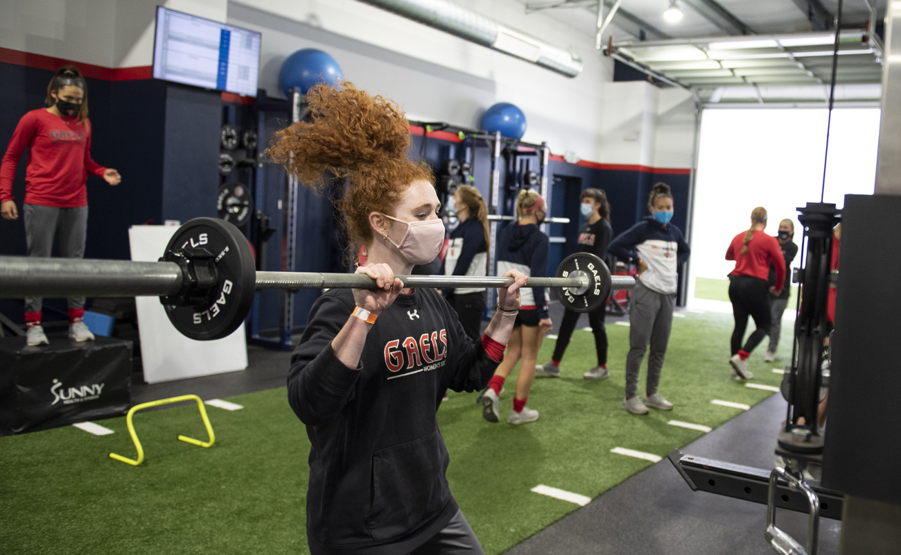 The women's soccer team conditions in the new Sports Performance Center.