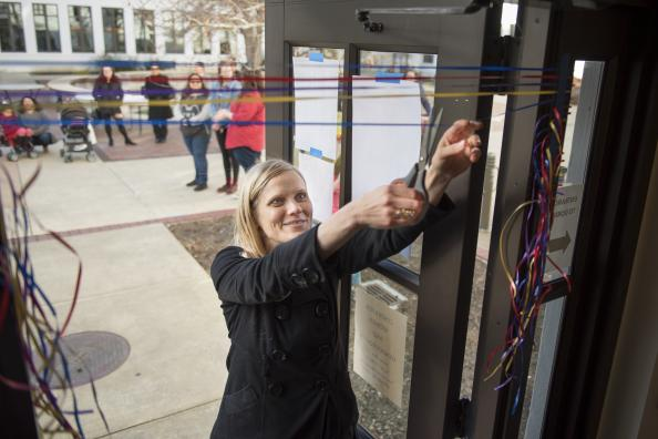 20 people, including Center staff, alums, and community members, cut 20 ribbons to celebrate 20 years on campus