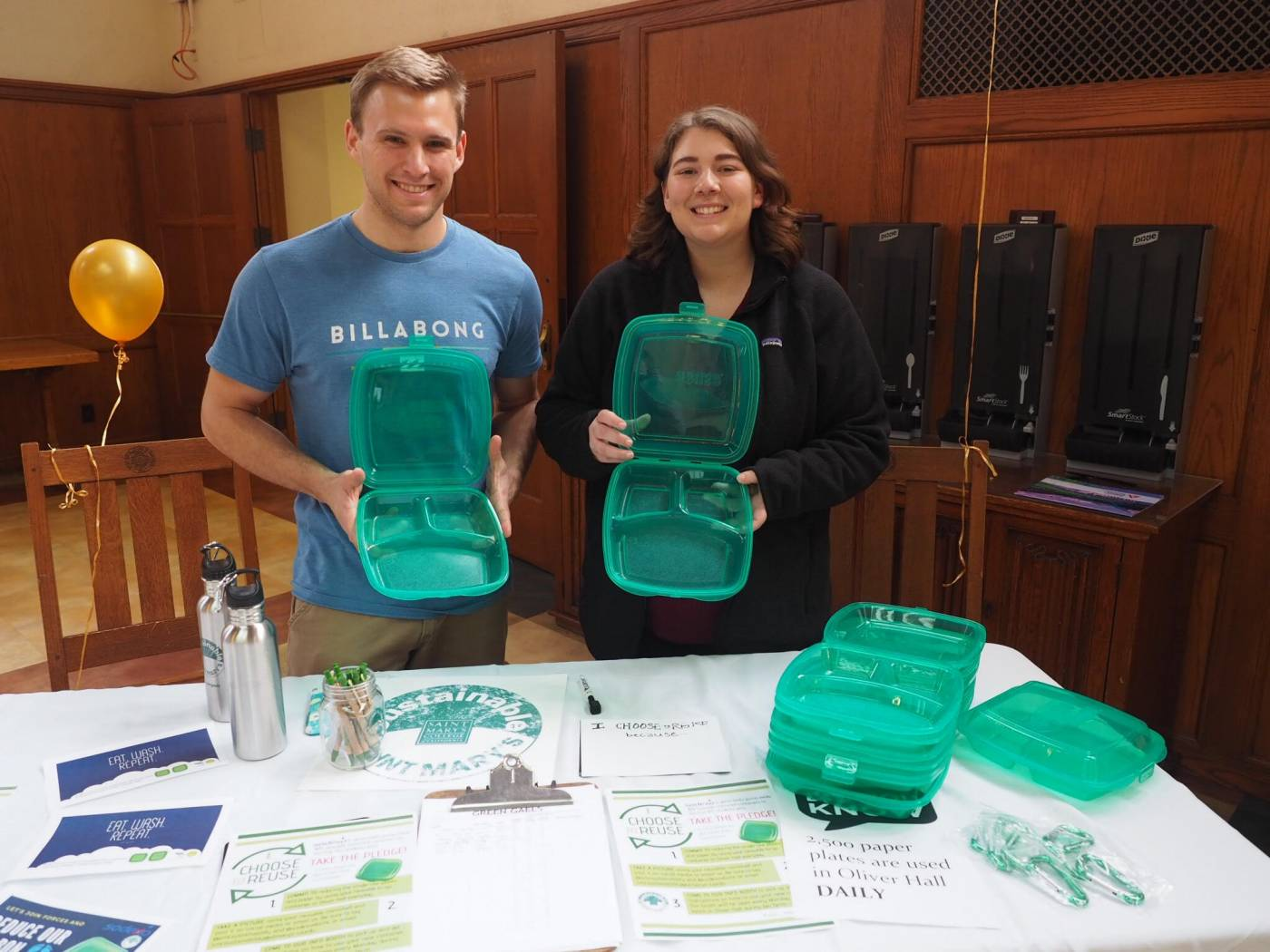 Sustainability staff promoting the Choose to Reuse containers at Oliver Hall.