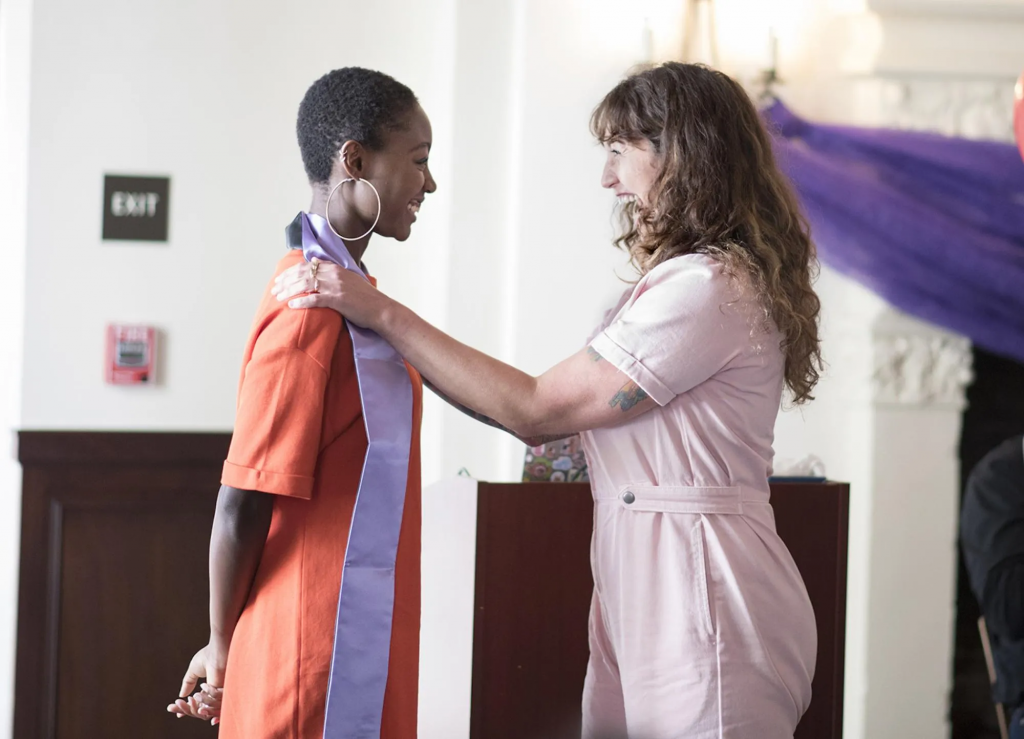 Photo of student receiving a Lavender sash