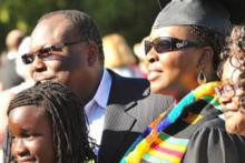 A student and her family at commencement